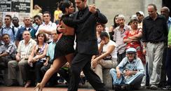 Couple dancing tango on streets