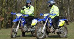Kent Police officers using off-road motorbikes