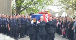 Jim Shears' coffin is carried into St George's