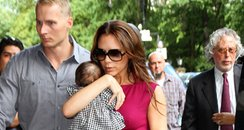 Victoria Beckham out with Harper