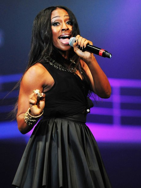 Alexandra Burke performing on stage