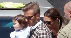 David and Victoria Beckham with Harper