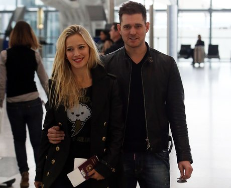 Michael Buble and Luisana Lopilato at Heathrow airport in London