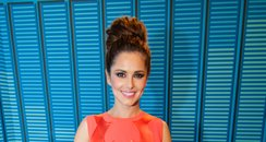 Cheryl wearing a top knot