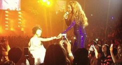 Beyonce with a toddler on stage