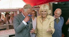 Prince Charles and Camilla trying oysters in Kent