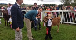 Wills talking to little boy and calf