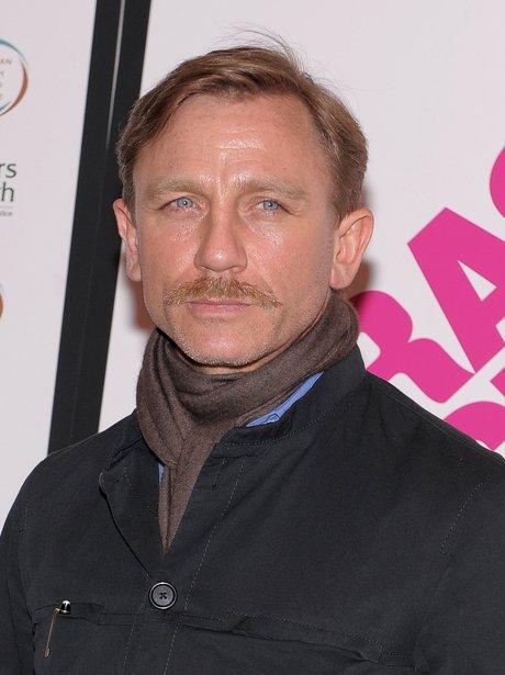 Daniel Craig with a moustache