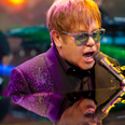 Elton John performing on stage