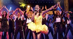 the cast on stage for The Bodyguard