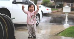 Girl discovering rain