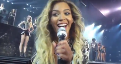 Beyonce singing in a microphone