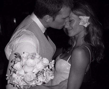 Black and white photograph of Gisele Bündchen and Tom Brady on their wedding day