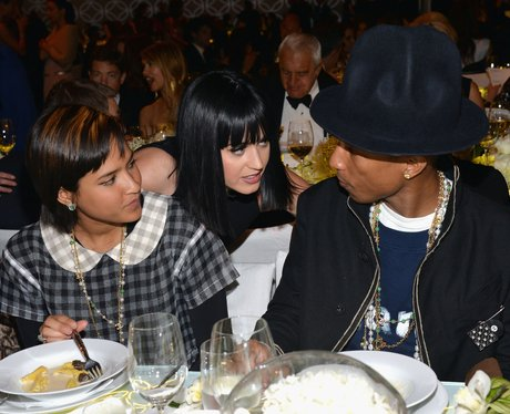 Pharrell and his wife at a dinner party
