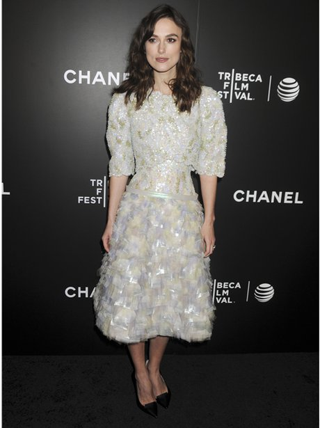 Keira Knightley in a white feathered dress