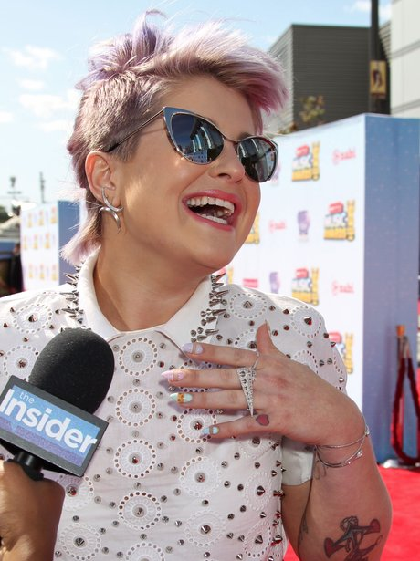 Kelly Osbourne laughing