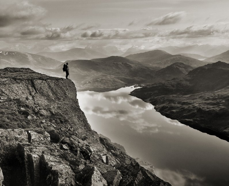 A person standing on a cliff