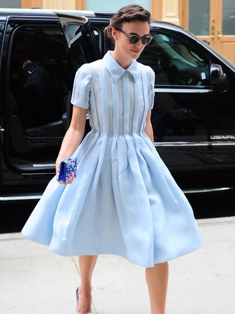 Keira Knightley wears this Prada, pleated shirt-dress just like Hepburn in New York City.