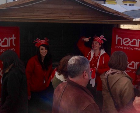People in face paint and Heart antlers outside heart chalet
