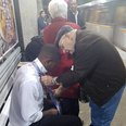Picture Of Elderly Couple Helping A Young Man With