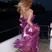 Image 1: Kylie Minogue in a purple dress