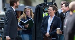 Olivia Colman and David Tennant on set of final se