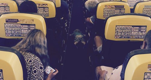 Little boy falls asleep face down in the aisle of