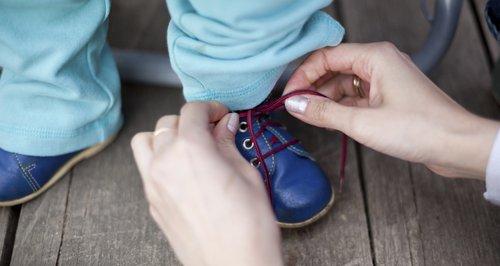 Tying children's shoelaces